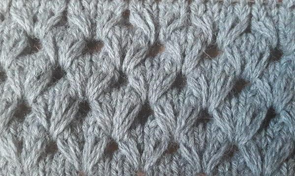 Гусиные лапки вытянутыми петлями спицами